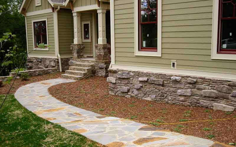 Stone pathway, entrance stairs and foundation wall